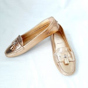 Louis Vuitton authentic NWOT gold lock loafers